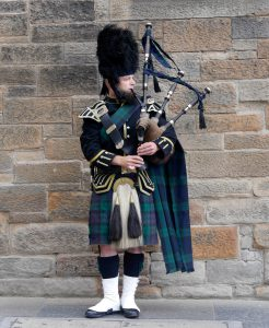 Scotland Edinburgh Bagpipes wearing Tartan Fabric